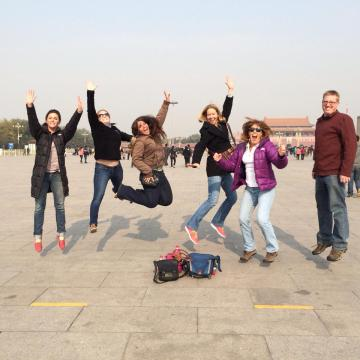 This is me with the EF staff at Tienanmen Square (you can see the Forbidden city in the background).  I was not told that I was supposed to flail my arms about - now I look silly jumping, and I look silly for not looking silly enough.