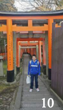 Eric under rows and rows of Japanese Torii Gates on the way to the Fushimi-Inari Taisha Shrine in Japan.