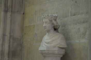 This bust is of Charles VII.  Located in the Basilica of St. Denis in Paris, the bust is in the main part of the church, while Charles VII's grave is directly beneath the marker in the crypts below the church.